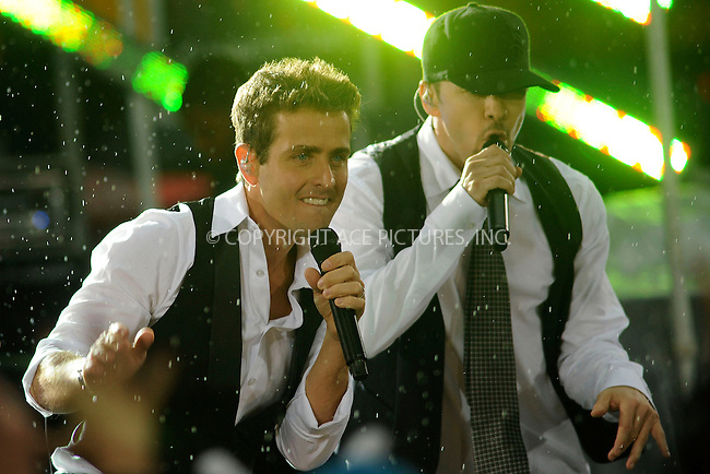 WWW.ACEPIXS.COM . . . . .....May 16, 2008. New York City,....Singers Joey McIntyre and Donnie Walhberg of the New Kids on the Block perform on the 'Today show in Rockefeller Plaza...  ....Please byline: Kristin Callahan - ACEPIXS.COM..... *** ***..Ace Pictures, Inc:  ..Philip Vaughan (646) 769 0430..e-mail: info@acepixs.com..web: http://www.acepixs.com