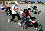 06/22/06....Gary Wilcox/The Times Union.....Siobhan Reigle (cq) pushes her daughter Keira Reigle  as part of her StrollerFit Class class held in Atlantic Beach. StrollerFit Class  is a beach workout that turns your stroller into a portable fitness machine. For more info on taking the call class call 904-997-8364.