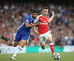 Arsenal's Laurent Koscielny tussles with Chelsea's Diego Costa during the Premier League match at the Emirates Stadium, London. Picture date September 24th, 2016 Pic David Klein/Sportimage