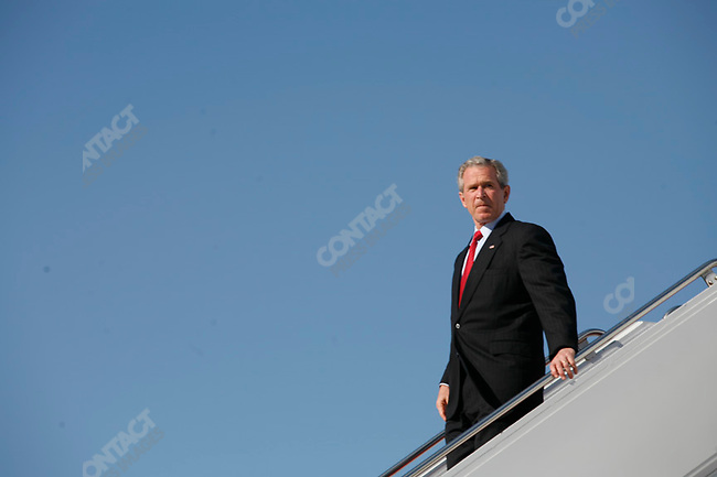 President George W. Bush with staff (Karl Rove, Scott McClellan) leave Air Force One at Andrews Air Force Base, MD, near Washington DC, after a trip to Alabama. April 19, 2006.