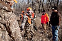 OutdoorLife Editor Andrew McKean (cq, middle) meet after hunting in Superior, Nebraska, Friday, December 2, 2011. ..Photo by Matt Nager
