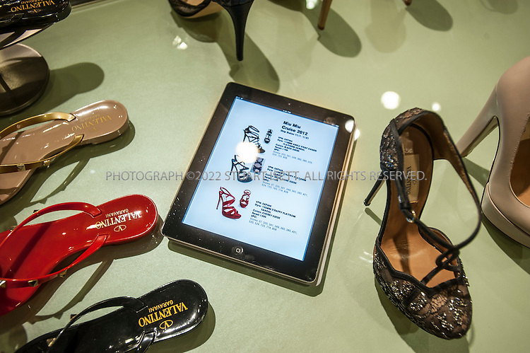 3/1/2012--Seattle, WA, USA..In the women's shoe department at Nordstrom in Seattle, WASH., an iPad is provided to customers to help them browse the store's website and catalog for items...©2012 Stuart Isett. All rights reserved.