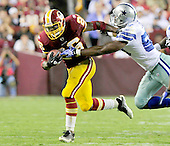Washington Redskins running back Clinton Portis (26) pushes off Dallas Cowboys' linebacker Bradie James (56) in fourth quarter action at FedEx Field in Landover, Maryland on Sunday, September 12, 2010. The Redskins won the game 13 - 7..Credit: Ron Sachs / CNP