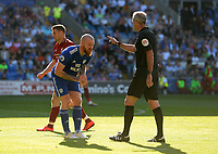 Cardiff City's Aron Gunnarsson has words with Referee  Martin Atkinson<br /> <br /> Photographer Ian Cook/CameraSport<br /> <br /> The Premier League - Cardiff City v Liverpool - Sunday 21st April 2019 - Cardiff City Stadium - Cardiff<br /> <br /> World Copyright © 2019 CameraSport. All rights reserved. 43 Linden Ave. Countesthorpe. Leicester. England. LE8 5PG - Tel: +44 (0) 116 277 4147 - admin@camerasport.com - www.camerasport.com