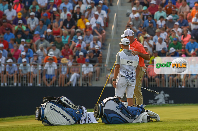 Stewart Cink (USA) puts his arm around his caddie/son as they watch Jason Day (AUS) putt out on 18 during 4th round of the 100th PGA Championship at Bellerive Country Club, St. Louis, Missouri. 8/12/2018.<br /> Picture: Golffile | Ken Murray<br /> <br /> All photo usage must carry mandatory copyright credit (© Golffile | Ken Murray)