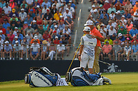 Stewart Cink (USA) puts his arm around his caddie/son as they watch Jason Day (AUS) putt out on 18 during 4th round of the 100th PGA Championship at Bellerive Country Club, St. Louis, Missouri. 8/12/2018.<br /> Picture: Golffile | Ken Murray<br /> <br /> All photo usage must carry mandatory copyright credit (&copy; Golffile | Ken Murray)