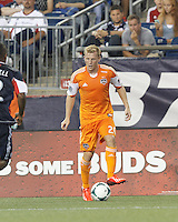 Houston Dynamo midfielder Andrew Driver (20) looks to pass. In a Major League Soccer (MLS) match, Houston Dynamo (orange) defeated the New England Revolution (blue), 2-1, at Gillette Stadium on July 13, 2013.