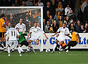 Wayne Gray of Cambridge United (r) attempts a late shot during the Blue Square Bet Premier match between Cambridge United and Newport County at the Abbey Stadium, Cambridge  on 25th September, 2010.© Kevin Coleman