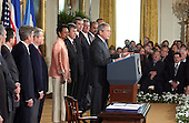 Washington, D.C. - August 2, 2005 --  United States President George W. Bush signs the Central America Free Trade Agreement (CAFTA) during a ceremony in the East Room of the White House in Washington, D.C. on August 2, 2005.  The agreement, between the United States and Costa Rica, El Salvador, Guatemala, Honduras, Nicaragua and the Dominican Republic, removes trade barriers and opens up the region to American goods and services. It also moves to facilitate investment in the area and strengthens protections for intellectual property.  It barely passed the House of Representatives by a 217 to 215 vote.  From left to right: Ambassador Salvador Stadthagen of Nicaragua; United States Representative William Jefferson (Republican of Louisiana); United States Senator Norm Coleman (Republican of Minnesota); United States Representative Clay Shaw (Republican of Florida); United States Senator Richard Lugar (Republican of Indiana); United States Secretary of State Condoleezza Rice; United States Secretary of Agriculture Mike Johanns; United States Secretary of Commerce Carlos Gutierrez; The President; Ambassador Tomas Duenas of Costa Rica (partially obscured); Ambassador Flavio Dario Espinal of the Dominican Republic; and Ambassador Rene Leon of El Salvador.<br /> Credit: Ron Sachs / CNP