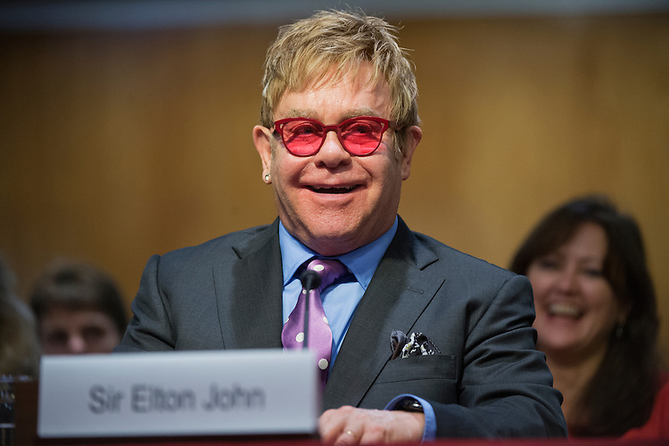 UNITED STATES - MAY 6: Musician Sir Elton John, founder of the Elton John AIDS Foundation, testifies before a Senate Appropriations State, Foreign Operations and Related Programs Subcommittee hearing in Dirksen Building on global health problems, May 6, 2015.(Photo By Tom Williams/CQ Roll Call)
