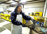STAFF PHOTO BEN GOFF  @NWABenGoff -- 12/11/14 Victor Sandoval, hazardous waste manager, demonstrates the operation of a can puncher machine used to safely evacuate the contents from aerosol cans for disposal at the Benton County Solid Waste District Household Hazardous Waste facility in Centerton on Thursday Dec. 11, 2014.