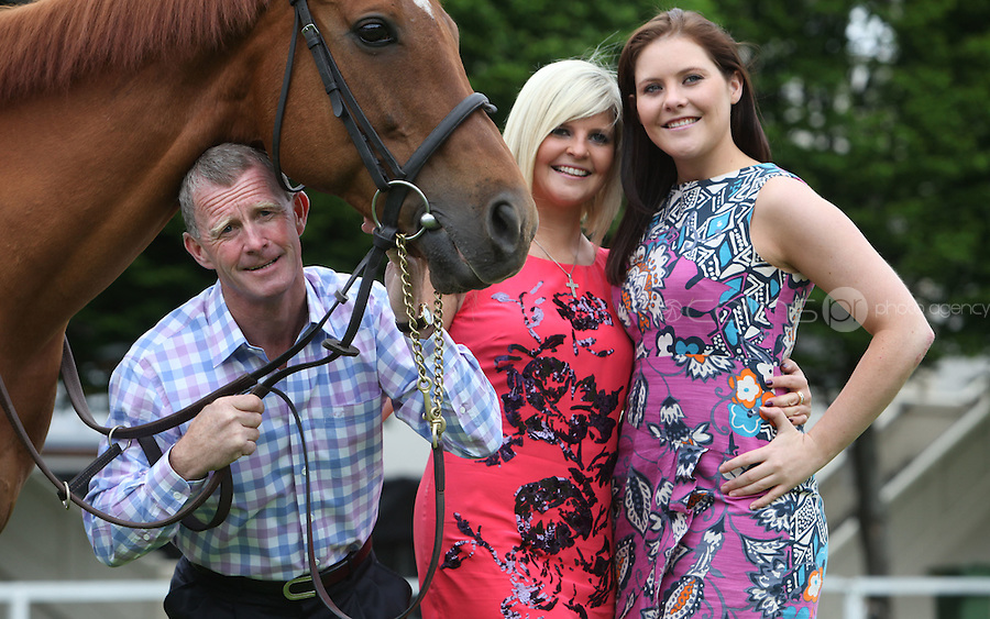 "14/06/2010.Retired top flat jockey Mick (michael) Kinane .with daughters.Sinead & Aisling Kinane & Horse ""Stay Cool"".at the launch of Father's Day with the National Lottery Sweepstakes game from the National Lottery in the RDS, Dublin..With less than a week until the final draw, a ticket from the National Lottery Sweepstakes is the perfect Father's Day gift. Limited to just 200,000 tickets, players have a chance to win a top prize of EUR1 million, as well as lots of other great cash prizes. The National Lottery Sweepstakes race will take place at the Curragh Racecourse on Sunday 27 June 2010. .Photo: Gareth Chaney Collins"