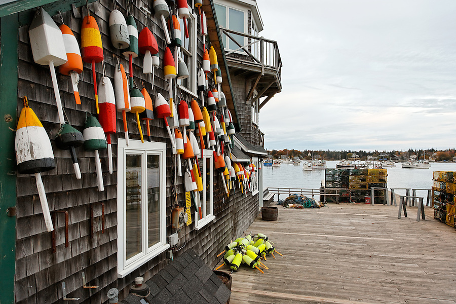 Fishing dock and storefront decorated with lobster trap bouys, Bernard, Tremont, Maine, USA