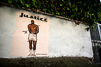 """Roma, 05/06/2020. Today, two pieces of Street Art showing George Floyd were spotted in Via Stati Uniti d'America in the Villaggio Olimpico in Rome. The two Graffiti/Stencil/Posters - """"Justice For George Floyd"""" and """"The Passion Of George Floyd"""" - are made by the street Artist Harry Greb (1.).<br /> The killing of George Floyd was perpetrated on the 25th May 2020 by police officers in the streets of Minneapolis while Mr Floyd was in custody under a knee of a police officer (2.). An independent autopsy cited by the CNN says Mr Floyd died """"of asphyxiation from sustained pressure"""", while """"the medical examiner's office made no mention of asphyxiation"""" citing as the cause of the death """"cardiopulmonary arrest complicating law enforcement subdual, restraint, and neck compression"""" (3.). The killing of George Floyd has sparked numerous antiracist protests across the US and in the rest of the world. <br /> <br /> Footnotes & Links:<br /> 1. https://harrygrebdesign.com/<br /> 2. """"8 Minutes and 46 Seconds: How George Floyd Was Killed in Police Custody"""" (Video, Source: Nytimes.com): http://bit.do/fFR9Z<br /> 3. (Source, CNN.com) http://bit.do/fFSah<br /> Live updates by the CNN (Source, CNN.com): http://bit.do/fFTKS"""