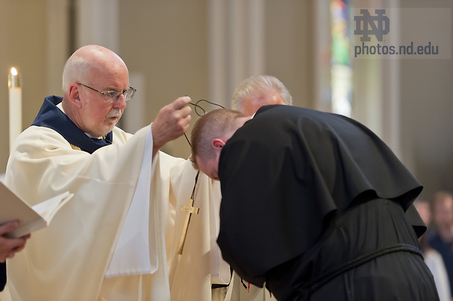 Aug. 25, 2012; Rev. Thomas O'Hara, C.S.C., Provincial Superior, places a crucifix around the neck of Mr. Jarrod Michael Waugh, C.S.C. at the profession of Final Vows...Photo by Matt Cashore/University of Notre Dame