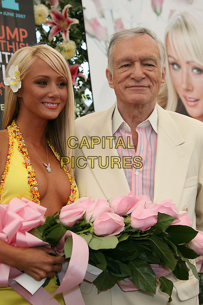 SARAH JEAN UNDERWOOD, HUGH HEFNER.2007 Playmate of the Year Luncheon held at the Playboy Mansion,  Holmby Hills, California, USA, 03 May 2007..half length pink flowers.CAP/ADM/RE.©Russ Elliot/AdMedia/Capital Pictures.