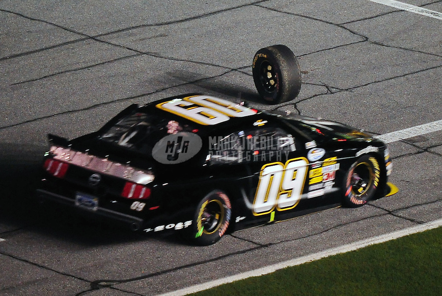 Jul. 2, 2010; Daytona Beach, FL, USA; NASCAR Nationwide Series driver Ken Schrader drives past a loose tire on pit road during the Subway Jalapeno 250 at Daytona International Speedway. Mandatory Credit: Mark J. Rebilas-