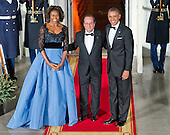 United States President Barack Obama, right, and first lady Michelle Obama pose for a photo with President Francois Hollande of France as Hollande arrives for a State Dinner in his honor on the North Portico of the White House in Washington, D.C. on Tuesday, February 11, 2014.<br /> Credit: Ron Sachs / CNP