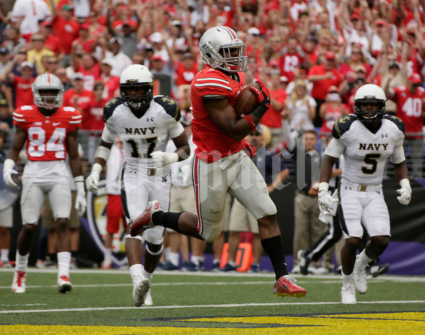 Ohio State Buckeyes running back Ezekiel Elliott (15) runs for a touchdown during Saturday's NCAA Division I football game against the Navy Midshipmen at M&T Bank Stadium in Baltimore on August 30, 2014. Ohio State won the game with a final score of 34-17. (Dispatch Photo by Barbara J. Perenic)