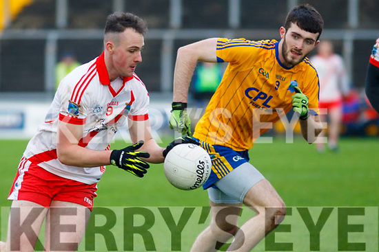 Sean Ó Gairbhí of An Ghaeltacht in possession as St Senans Stephen O'Connell keeps a close eye on him, in the Munster Intermediate final in Austin Stack Park, Tralee on Sunday last.