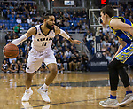 Nevada forward Cody Martin (11) drives around San Jose State forward Noah Baumann (20) in the first half of an NCAA college basketball game in Reno, Nev., Wednesday, Jan. 9, 2019. (AP Photo/Tom R. Smedes)