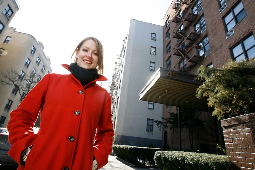 Interior Designer, Heather Groff in front of 45 Overlook Terrace in the Inwood section of Manhattan, New York.  Groff, 30, is in the process of buying a one bedroom apartment in the building.