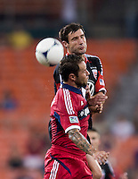Chris Pontius (13) of D.C. United goes up for a header with Daniel Paladini (11) of the Chicago Fire at RFK Stadium in Washington, DC.  D.C. United defeated the Chicago Fire, 4-2.