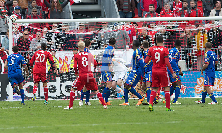 Toronto, Ontario - April 12, 2014: Toronto FC midfielder Kyle Bekker #8 takes a free kick which just hits the bar of the net during the 2nd half in a game between the Colorado Rapids and Toronto FC at BMO Field in Toronto.<br /> Colorado Rapids won 1-0.