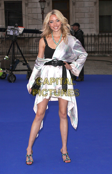 NOELLE RENO .Royal Academy of Arts Summer Exhibition Preview Party at the Royal Academy, Piccadilly, London, England. June 3rd, 2009..full length silver kimono dress black waist belt sandals clutch bag hand on hip .CAP/AH.©Adam Houghton/Capital Pictures