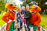 Francis P Fox. and Freddy the Fox with Leona, John and Faye Enright from Ardfert enjoying the afternoon in the Town Park at the Féile na mBláth on Saturday.