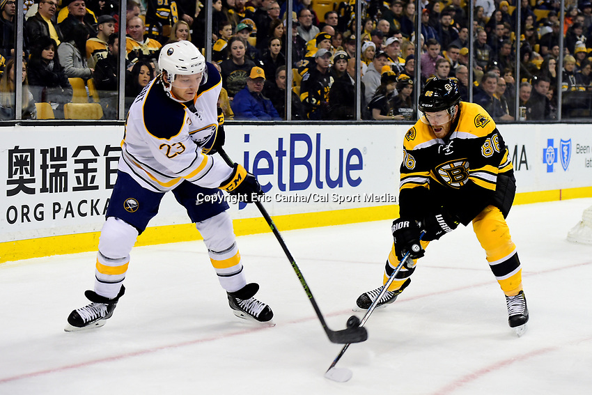 Saturday, December 31, 2016: Boston Bruins defenseman Kevan Miller (86) and Buffalo Sabres center Sam Reinhart (23) in game action during the National Hockey League game between the Buffalo Sabres and the Boston Bruins held at TD Garden, in Boston, Mass. Boston defeats Buffalo 3-1.  Eric Canha/CSM