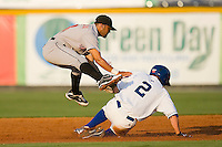 Ricardo Garcia #13 of the Greeneville Astros leaps over Alex McClure #2 of the Burlington Royals after making a throw to first base at Burlington Athletic Stadium June22, 2010, in Burlington, North Carolina.  Photo by Brian Westerholt / Four Seam Images
