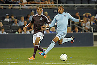 Sporting forward Teal Bunbury (9) watched by Tyrone Marshall..Sporting Kansas City defeated Colorado Rapids 2-0 in Open Cup play at LIVESTRONG Sporting Park, Kansas City, Kansas.