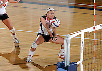 WKU defensive specialist Sarah Rogers (1) plays against Florida International in the semi-finals of the Sunbelt Conference Volleyball Tournament.  Western Kentucky won the match 3-0 on November 18, 2011 at Miami, Florida. .