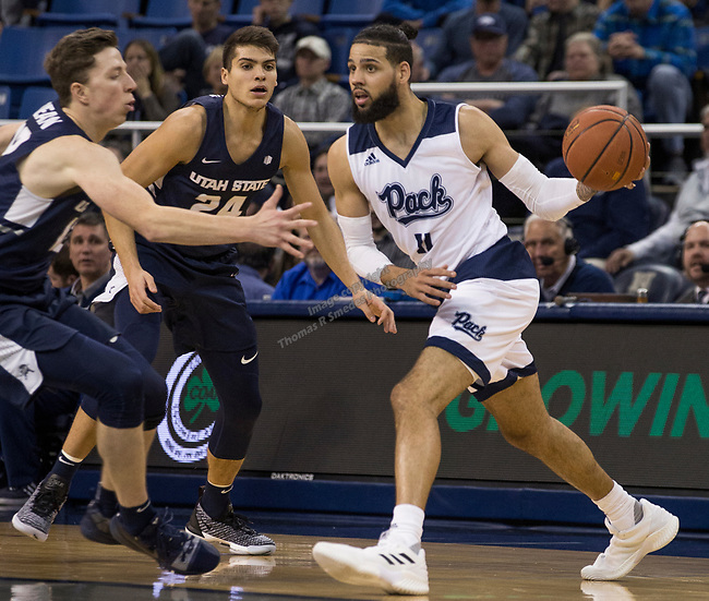 Nevada forward Cody Martin (11) looks to pass the ball against Utah State in the second half of an NCAA college basketball game in Reno, Nev., Wednesday, Jan. 2, 2019. (AP Photo/Tom R. Smedes)