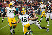 Reigning NFL MVP Aaron Rodgers looks to the ref for a flag to protest what he considered a late tackle by JJ Watt as the visiting Green Bay Packers defeated the Houston Texans 42-24 at Reliant Stadium.