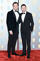 Tarron Eggerton and Jamie Bell<br /> arriving for the BAFTA Film Awards 2019 at the Royal Albert Hall, London<br /> <br /> ©Ash Knotek  D3478  10/02/2019