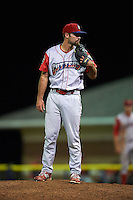 Williamsport Crosscutters pitcher Skylar Hunter (25) looks in for the sign during a game against the Batavia Muckdogs on August 27, 2015 at Dwyer Stadium in Batavia, New York.  Batavia defeated Williamsport 3-2.  (Mike Janes/Four Seam Images)
