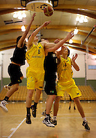 Players compete for a rebound. 2010 FIBA Oceania U18 Championship - NZ Junior Tall Blacks v Australian Emus at Arena Manawatu, Palmerston North on Friday, 17 September 2010. Photo: Dave Lintott/lintottphoto.co.nz