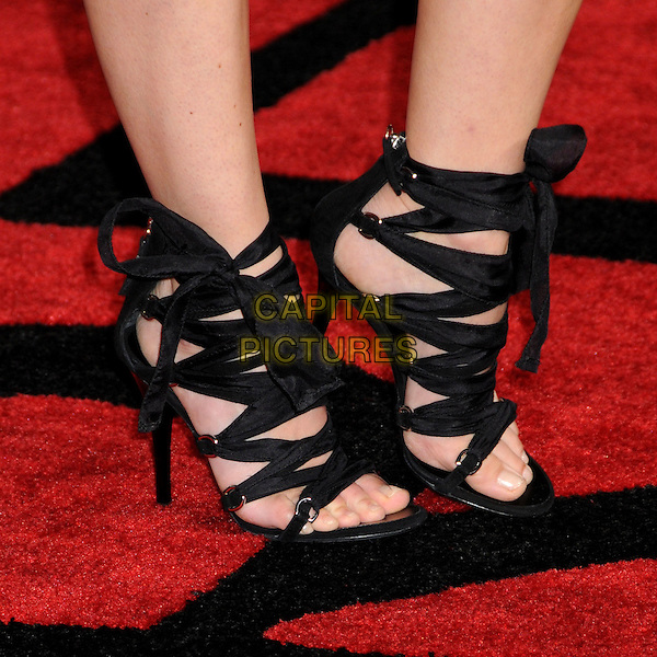 "KERI RUSSELL's shoes .""Extraordinary Measures"" Los Angeles Premiere held at Grauman's Chinese Theatre, Hollywood, California, USA..January 19th, 2010.black feet heels straps ankle bow .CAP/ADM/BP.©Byron Purvis/AdMedia/Capital Pictures."