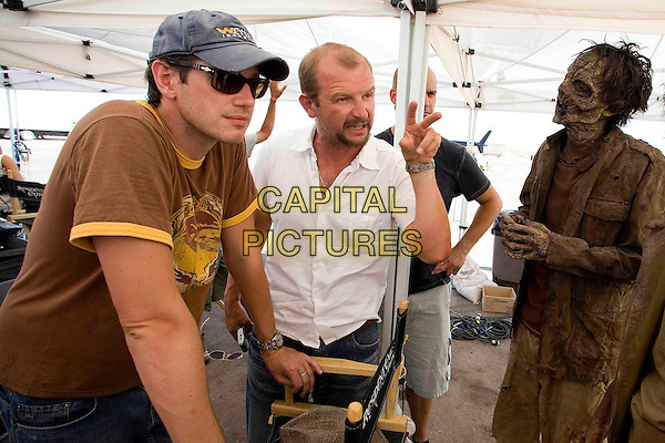 PAUL ANDERSON (PRODUCER / WRITER) & JEREMY BOLT (PRODUCER).on the set of Resident Evil: Extinction .*Filmstill - Editorial Use Only*.CAP/FB.Supplied by Capital Pictures.