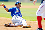 18 March 2006: Carlos Gomez, outfielder for the New York Mets, slides safely into third for a triple during a Spring Training game against the Washington Nationals at Space Coast Stadium, in Viera, Florida. The Nationals defeated the Mets 10-2 in Grapefruit League play...Mandatory Photo Credit: Ed Wolfstein Photo..