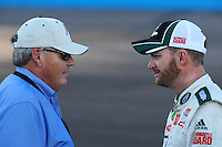 Nov. 7, 2008; Avondale, AZ, USA; NASCAR Sprint Cup Series driver Dale Earnhardt Jr (right) talks with team owner Rick Hendrick during qualifying for the Checker Auto Parts 500 at Phoenix International Raceway. Mandatory Credit: Mark J. Rebilas-