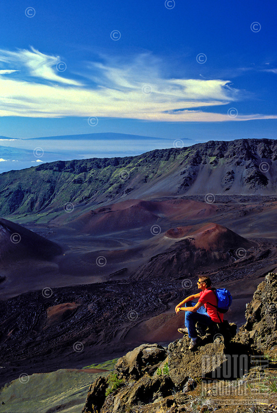 Hiker takes in the beauty of Haleakala Crater, Maui.