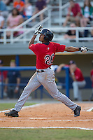 LaMonte Wade (26) of the Elizabethton Twins follows through on his swing against the Kingsport Mets at Hunter Wright Stadium on July 9, 2015 in Kingsport, Tennessee.  The Twins defeated the Mets 9-7 in 11 innings. (Brian Westerholt/Four Seam Images)