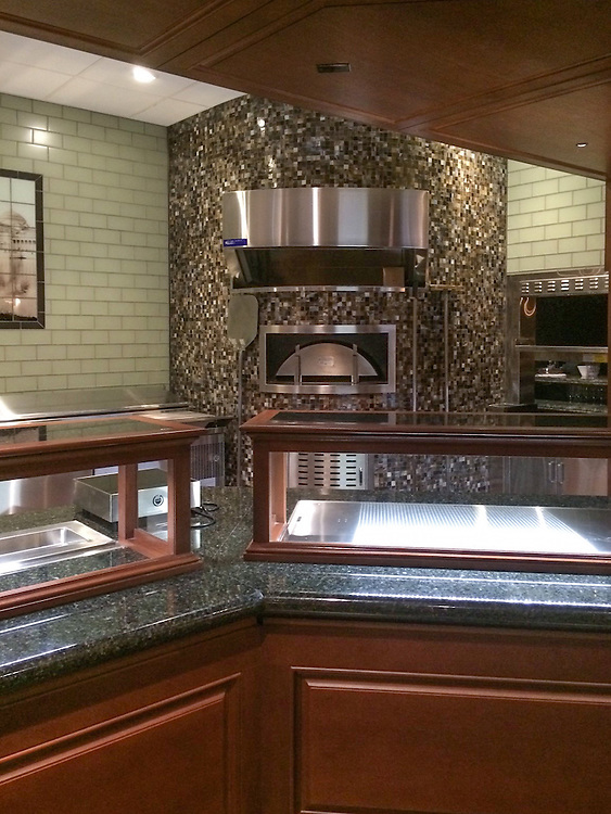This custom commercial oven features a Gridded 3cm handmade mosaic shown in Schist jewel glass by New Ravenna. <br /> -photo courtesy of Symmetry Pointe<br /> <br /> For pricing samples and design help, click here: http://www.newravenna.com/showrooms/