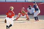 MADISON, WI - APRIL 17: Pitcher Letty Olivarez #12 of the Wisconsin Badgers softball team pitches the ball to catcher Joe Daniels #3 against the University of Illinois-Chicago at Goodman Diamond on April 17, 2007 in Madison, Wisconsin. (Photo by David Stluka)