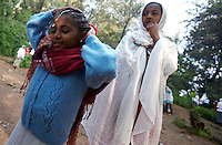 Misa, 12 years old,HIV positive, pours holy wateron her head in an orthodox church where she can drink holy water that is belived by her family to heal from the virus in Addis Ababa, Ethiopia on Sunday July 16 2006.. Ethiopia is one of the countries most affected by HIV/AIDS. Of its population of 77 million, three million are HIV-positive, according to government statistics. Every day sees 1,000 new infections. A million children under 14 have lost one or both parents to AIDS, and 200,000 children are living with AIDS. That makes Ethiopia the country with the most HIV-positive children.