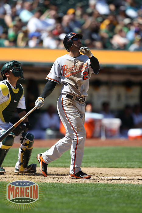OAKLAND, CA - APRIL 18:  Nick Markakis #21 of the Baltimore Orioles bats against the Oakland Athletics during the game at the Oakland-Alameda County Coliseum on April 18, 2010 in Oakland, California. The Orioles beat the A's 8-3. Photo by Brad Mangin