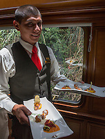 Peru, Machu Picchu.  Serving Lunch on the Inca Rail Executive Class Train from Ollantaytambo to Machu Picchu.